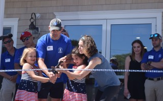 With help from daughters Hattie and Jane, Lindsay and Fred Bierwirth cut the ribbon on their new fitness center and co-working business, Chatham Works, on Monday. TIM WOOD PHOTO  (photo: )