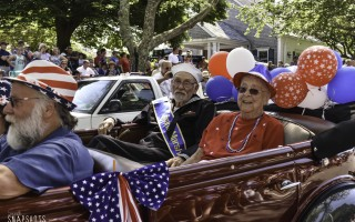 Grand Marshall Ivan Bassett and his wife of 71 years, Florence, enjoy the ride along the Chatham Parade route.  (photo: Kat Szmit)