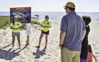 Atlantic White Shark Conservancy intern Nikki Tenaglia and summer program educator Haley Currie share important shark safety information with visitors of Lighthouse Beach in Chatham on July 3 as part of the new AWSC Shark Smart Beach Program. Kat Szmit Photo  (photo: )