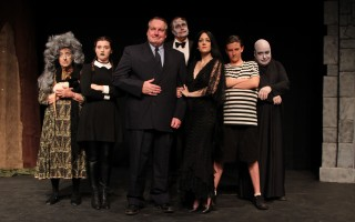 "The cast of ""The Addams Family"" at the Chatham Drama Guild. From left, Karen McPherson (Grandma), Susanna Creel (Wednesday Addams), Scott Hamilton (Gomez Addams), Mike Guzowski (Lurch), Rebecca Banas (Morticia Addams), Thelonious Shores (Pugsley), Jim Batzer (Uncle Fester). DELANE MOSER PHOTO  (photo: )"