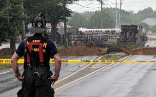 A Harwich firefighter monitors the spill from the north side of Sisson Road.  ALAN POLLOCK PHOTO  (photo: Alan Pollock)