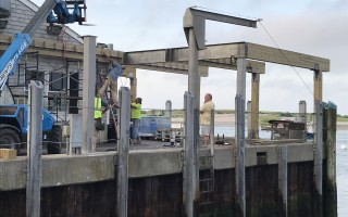 Harbormaster Stuart Smith watches as the construction crew works on the new observation deck at the fish pier Friday. TIM WOOD PHOTO  (photo: Tim Wood)