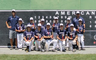 The Monomoy Little League 12-year-old All Stars celebrate another championship victory near the end of a stellar 2019 season. Team members include: No. 3 Braden Burke, No. 6 Xavier Doyle, No. 15 Lilly Furman, No. 22 Casey Huse, No. 12 Finn Hyora, No. 11 Marek Krystofolski, No. 18 Ryan Laramee, No. 8 Jackson Morneau, No. 24, Max Ramler, No. 2 Chace Robbins, No. 5 Jackson Rocco, and No. 44 Chase Yarletts with coaches Jay Krystofolski and Mick Huse.  (photo: )