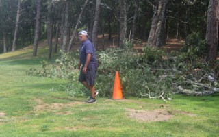 "Cranberry Valley Golf Course Superintendent Shawn Fernandez marks a ""wood hazard"" on the second fairway resulting from the recent tornado.  WILLIAM F. GALVIN PHOTO  (photo: William F. Galvin)"