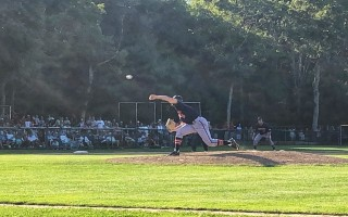 Harwich hurler Cam Baumann pitches against Cotuit Friday. KAT SZMIT PHOTO  (photo: )