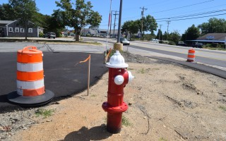 A fire hydrant and safety barrels mark the area near the George Ryder Road-Route 28 intersection where a new roundabout will be built this fall. TIM WOOD PHOTO   (photo: )