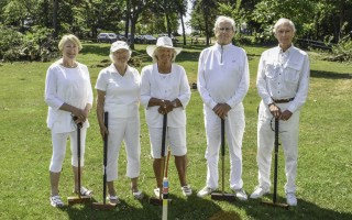 Members of the Chase Park Croquet Club—Sally Stratman, Lisa Edge, Connie Loomis, Dan Brown, and Don Edge—enjoy a friendly match at Chase Park in Chatham.  KAT SZMIT PHOTO  (photo: Kat Szmit)