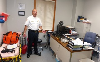 Fire Chief Anthony Pike stands in a room in transition. The former first aid station must move to accommodate the new emergency medical services director, and staff are still looking for a new location in their cramped quarters.  ED MARONEY PHOTO  (photo: Ed Maroney)