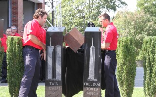 Firefighters unveil the new 9/11 memorial at the Harwich fire station Wednesday.  ALAN POLLOCK PHOTOS  (photo: Alan Pollock)