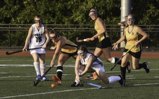 Monomoy defender Nikki Awalt (7) redirects the ball away from Nauset's Kay McNamara (10) as Monomoy's Holly Evans (18) and Nauset's Layne McIntire (18 gold) and Grace Murphy (19) look to lend support during game play at Monomoy on Sept. 11. Kat Szmit Photo  (photo: Kat Szmit)