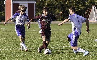 Cape Tech's Pedro Afonso (7) keeps the ball away from Upper Cape Tech opponents Nate Baronas (12) and Noah Tetrault (5). Kat Szmit Photo  (photo: Kat Szmit)