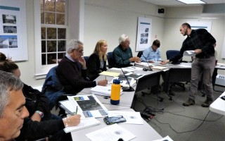 Members of the affordable housing trust (left to right, Henry Brehm, Alexis Mathison, Ward Ghory, Katie Wibby, Alan McClennen, and Matt Cole) received packets from Orleans Conservation Trust Director Stephen O'Grady at last week's housing trust meeting.  ED MARONEY PHOTO  (photo: Ed Maroney)