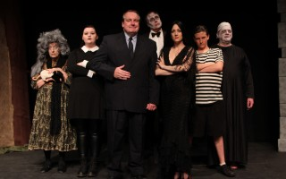 "The cast of ""The Addams Family"" at the Chatham Drama Guild. From left, Karen McPherson (Grandma), Virginia Ohlson (Wednesday Addams), Scott Hamilton (Gomez Addams), Mike Guzowski (Lurch), Rebecca Banas (Morticia Addams), Thelonious Shores (Pugsley), and Todd Cashdollar (Uncle Fester). DELANE MOSER PHOTO  (photo: )"