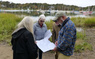 Peg LoPresto, a William Raveis Realtor (second from left), showed a map of the Peck property on Arey's Pond to Stephanie Gaskill, Robert Cunningham, and Hardie Truesdale of the town's open space committee.  ED MARONEY PHOTO  (photo: Ed Maroney)