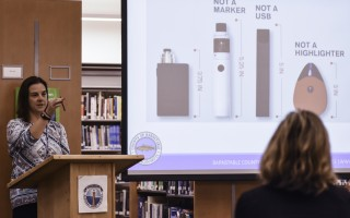 Kim Slade, a substance abuse prevention manager and vaping expert with the Barnstable County Dept. of Human Services, shows a handful of parents at Monomoy Regional High School's Oct. 16 Parent University one of many vaporizer products students use.  KAT SZMIT PHOTO  (photo: Kat Szmit)