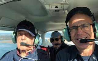 Pilot Kyle Takakjian, right, with Eugene Peterson, left, and George Vermelyea, center, in the cockpit during last Thursday's flight. COURTESY PHOTO  (photo: )