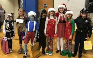 Fifth grade winners, from left, Lily Laposky, Zoe Simmons, Finnigan Buck, Abigail Leighton, Riley Vath, Rory Shortis, Sydney Welch, and Carly Boutin.  (photo: )