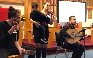 Palestinian musicians perform at the Tree of Life conference in Harwich Sunday. From left, Alber Baseel, Nadine Shomali (holding son Hani) and Tamer Al-Sahouri. JENNY WOOD PHOTO  (photo: )