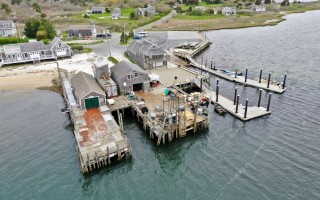 The Eldredge trap dock, seen here between Old Mill Boatyard on the right and the Stage Harbor Yacht Club pier on the left, will be rebuilt in a $2.6 million project scheduled to be completed by May. TOWN OF CHATHAM PHOTO  (photo: )