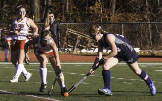 Monomoy's Holly Evans (18) works to keep the ball away from Holliston's Isabelle Larche (2) during the MIAA Div. 2 South first round on Nov. 1. Kat Szmit Photo  (photo: Kat Szmit)