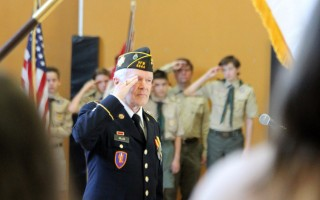 SPC Ted Miller, U.S. Army, Ret., salutes during the singing of the National Anthem during Monday's Veterans Day observance in Chatham.   ALAN POLLOCK PHOTOS  (photo: Alan Pollock)