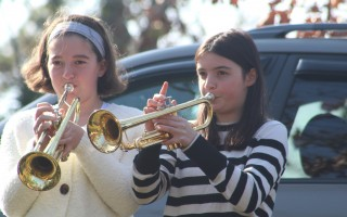 Seventh graders Amy Hoye and Morgan Crowe play Taps at the Veterans Day ceremony in Island Pond Cemetery on Monday.  WILLIAM F. GALVIN PHOTO  (photo: William F. Galvin)