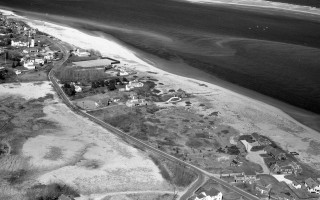 This aerial photograph shows the sparse development of the northern section of Little Beach in 1964. Chatham Light can be seen at the upper left, with the intersection of Morris Island and Little Beach roads on the lower right. COURTESY OF SPENCER KENNARD   (photo: Richard Kelsey)