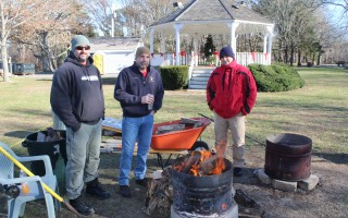 Firefighter Brian Warner, Deputy Fire Chief David LeBlanc and firefighter Justin White were trying to stay warm during last year's Homeless for the Holidays donation drive in Brooks Park. CHRONICLE FILE PHOTO  (photo: )