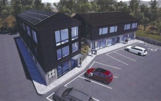 A new look is proposed for the two buildings to the right of Baskin's Ace Hardware, but there are concerns about its compatibility with other structures in the area.  S.A. ARCHITECTURE, INC. GRAPHIC  (photo: S.A. Architecture, Inc.)