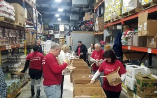 Volunteers from Bank of America help sort donated food and restock the shelves of the Family Pantry last week. ERIC FEHRNSTROM PHOTO  (photo: Eric Fehrnstrom)