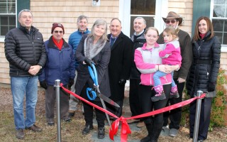 Celebrating the new rental escrow home Saturday are (from left) David Oppenheim; Selectmen Dean Nicastro, Cory Metters, Shareen Davis, Jeffrey Dykens and Peter Cocolis; Summer and young Aubrey Fulcher; John Stewart of the Chatham Housing Authority and Chatham Town Manager Jill Goldsmith. ALAN POLLOCK PHOTO  (photo: Alan Pollock)