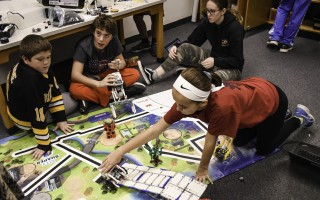 Monomoy Regional Middle School Robotics Club members Nolan Baker, Kenny Watts, Maya Jones and Natalie Sims work on properly programming their Lego EV3 to perform a specific challenge that will be part of the state competition.  KAT SZMIT PHOTOS  (photo: )