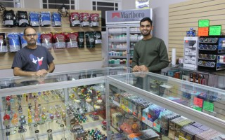 Perry and Alay Patel are working the newly opened Royal Smoke Shop in Harwich Center. WILLIAM F. GALVIN PHOTO  (photo: William F. Galvin)