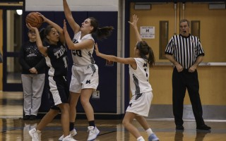 Monomoy's Courtney Kelley (20) and Lucy Mawn (1) work to stop Rising Tide's Cai Blake (11) from scoring during game play on Dec. 18. Kat Szmit Photo  (photo: )