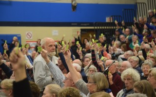 Teller Bruce Beane counts votes during Saturday's special town meeting in Chatham. TIM WOOD PHOTO  (photo: )
