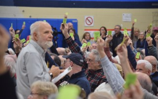 Teller Bruce Beane counts votes during Saturday's special town meeting in Chatham. TIM WOOD PHOTO  (photo: Tim Wood)