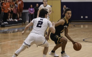 Nauset's Keleb Daniels (21) works on getting past Monomoy's Elijah Beasley (2) en route to the hoop during game play Jan. 4 at Monomoy. Kat Szmit Photo  (photo: )