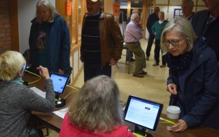 Voters were checked-in at the Jan. 4 special town meeting using an iPad system for the first time. TIM WOOD PHOTO  (photo: )