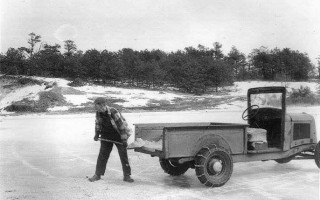 John E. Hall hand-sanding Reservoir Bogs on the ice in Harwich, 1958. Photo courtesy of Alan J. Hall  (photo: )