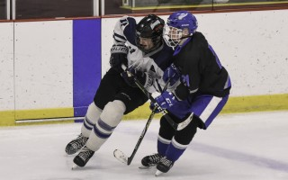 The Monarchs' Brant Butcher (17) leans into Wareham-Carver opponent Zachary Barris in the hopes of slowing him down a bit during game play Jan. 20 in Hyannis. Kat Szmit Photo  (photo: )