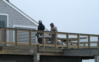Two construction employees work on the fish pier observation deck last week.  A similar number of employees have been on site most workdays since before the holidays.  ALAN POLLOCK PHOTO  (photo: Alan Pollock)