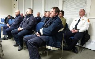 Personnel from the fire and rescue department showed up in numbers Jan. 22 as the selectmen debated how to find retiring Chief Anthony Pike's successor. Deputy Chief Geof Deering, who would become acting chief if a new leader is not hired by Feb. 22, Pike's last day, was in the back row at far right.  ED MARONEY PHOTO  (photo: Ed Maroney)