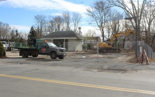 New development for Harwich Center got underway this week with the lot holding the former gas station in the center of the village being cleared so the foundation for the new convenience store with two apartments above can be put in place. WILLIAM F. GALVIN PHOTO  (photo: William F. Galvin)