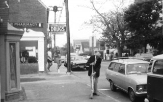 George Payne's father sweeping  the sidewalk in front of the Squire. July 1973. FILE PHOTO  (photo: )