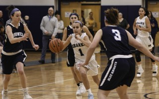 Monomoy's Lucy Mawn (1) breaks through a trio of Sandwich defenders as she moves the ball into scoring position during game play Jan. 23. Kat Szmit Photo  (photo: )