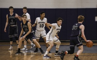 Monomoy's Elijah Beasley (2), Eli Stafford (10), and Joe DeMango (11) get into a defensive mode during game play against Sturgis East on Jan. 31. Kat Szmit Photo  (photo: )