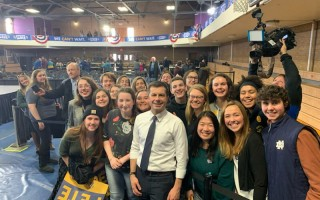 Members of Monomoy Regional High School's Political Action Club share a moment with presidential candidate Pete Buttigieg at the Iowa Caucus. Contributed Photo  (photo: )