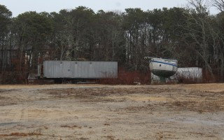 A portion of the residential district on the site where the proposed 36-hole miniature golf course is proposed is now being used for storage of a boat and trailers and piles of earth are also often placed there. WILLIAM F. GALVIN PHOTO    (photo: William F. Galvin)