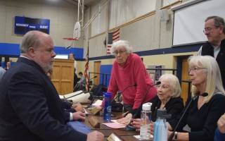 At January's special town meeting, Chatham Finance Committee Chairman Stephen Daniel, left, consults with committee members Florence Seldin, Jo Ann Sprague, Andrew Young and Barbara Matteson. FILE PHOTO  (photo: Tim Wood)