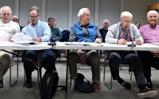 Last year's town meeting and ballot votes to spend $47 million on wastewater remediation put implementation of the plan on the shoulders of the board of water and sewer commissioners, seen here at a Feb. 12 meeting with the board of selectmen.  ED MARONEY PHOTO  (photo: Ed Maroney)